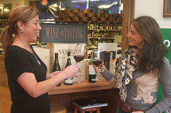 "On location with Cynthia Murray, Vice President of Marketing at The Bottle Shop in Spring Lake, for a December 2013 Asbury Park Press article on ""Winter Wines"""