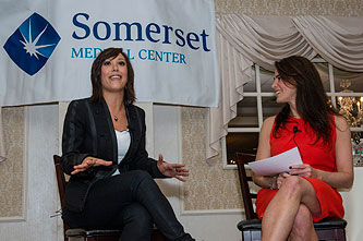 "At Somerville, NJ-based Somerset Medical Center's special ""Heart Health"" event in February 2014, Susan conducted a moderated interview with Dancing With the Stars' Cheryl Burke (left) for an audience of over 350 (photo by Ron Wyatt)"