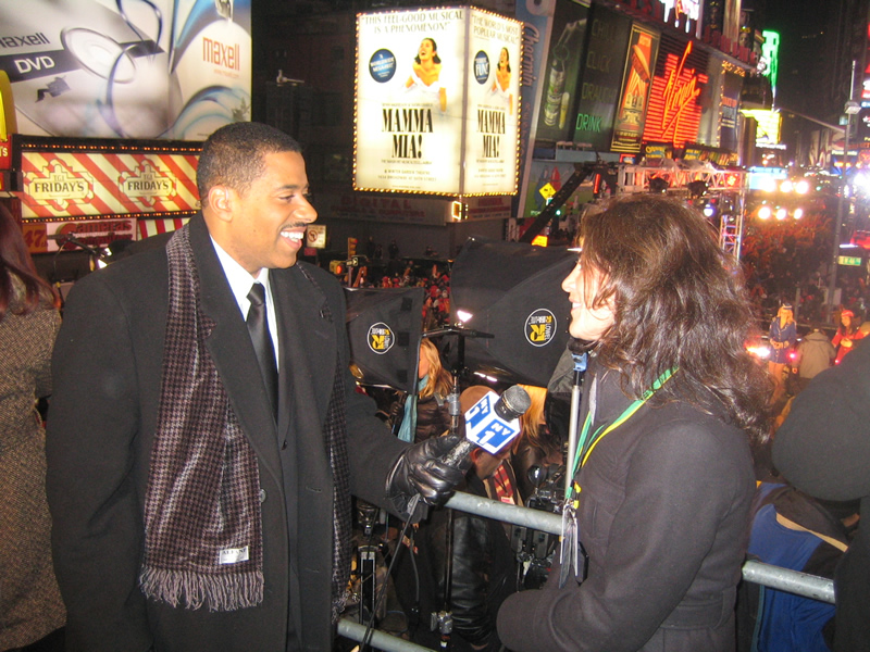 Conducting an interview on the Times Square Ball with a reporter from NY1 during New Year's Eve in Times Square