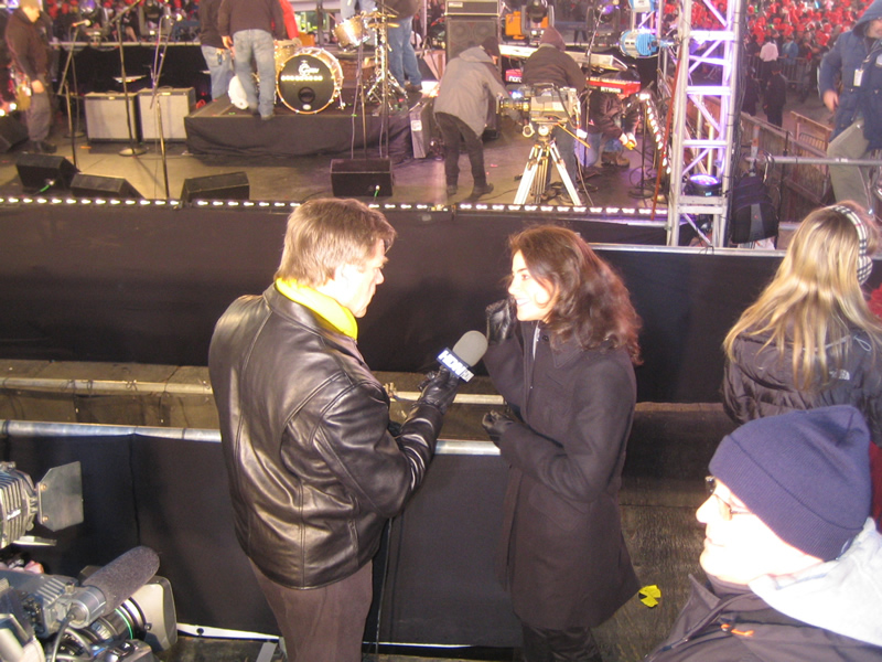 Conducting an interview on the Times Square Ball with a reporter during New Year's Eve in Times Square